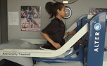 Senior cross-country runner Ashley Brasovan runs on the team's new Alter G treadmill, purchased in April.