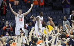 Joe Harris, left, celebrates with fans after scoring a career-high 36 points to lead Virginia to an upset win over No. 3 Duke.