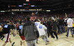Maryland fans stormed the court following their team's 83-81 win over Duke.