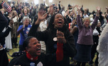 Local Democrats cheers as results roll in, showing a victory for President Barack Obama.