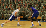 Alex Murphy, left, and Amile Jefferson, right, run drills in front of the troops at Fort Bragg Saturday.