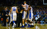Duke head coach Mike Krzyzewski hugs Mason Plumlee at midcourt, firing up the Blue Devils as they pushed past Georgia Tech.