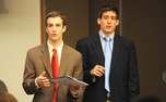 Seniors Justin Robinette, former Duke College Republicans chair, and Cliff Satell, former DCR vice chair, testify regarding DCR's hostile atmosphere at the Duke Student Government meeting Wednesday night.