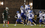 The Blue Devils celebrate after upsetting No. 4 Loyola 9-8.
