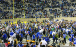 Students stormed the field after Duke's bowl-clinching win vs. UNC and will get free tickets to the game in Charlotte.