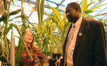 Adjunct professor of biology Mary Eubanks shows Akec Khoc, South Sudanese ambassador to the United States, a strain of maize that could boost the country's agricultural capabilities.