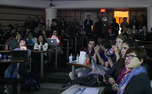 Students watch the results roll in at a watch party at the Sanford School of Public Policy.