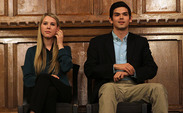 Juniors Stefani Jones and Patrick Oathout, DSG presidential candidates, debate campus issues in the Great Hall Sunday evening.
