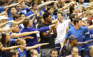 Duke signee Justise Winslow spent the second half of Monday's win against Virginia watching the game with the Cameron Crazies.