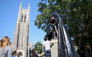 Members of DukeOpen wrap the James B. Duke statue on West Campus to promote endowment transparency.