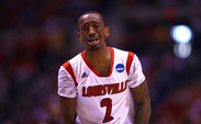 Louisville star Russ Smith reacts emotionally to Kevin Ware's gruesome leg fracture in the first half of the Cardinals' Elite Eight win against Duke.
