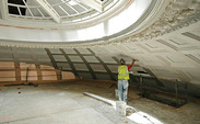 A construction worker repairs the Baldwin Auditorium inner dome. Renovations to the building are expected to be finished within the 2013-2014 academic year.