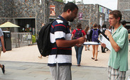 Students register people to vote on the Bryan Center Plaza to get people to the polls on Election Day.