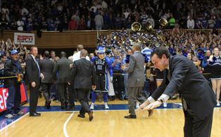 Coach K bows to the Cameron Crazies in gratitude after last night's 73-68 win vs. Ohio State. (Photo by Faith Robertson/The Chronicle)