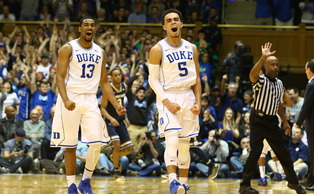 Tyus Jones and Matt Jones react during the Blue Devils' 43-7 run that blew the game open in the first half.
