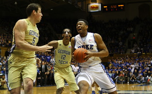 Jabari Parker struggled for the second straight game, but Rodney Hood's hot shooting was enough to propel Duke to its first conference win.