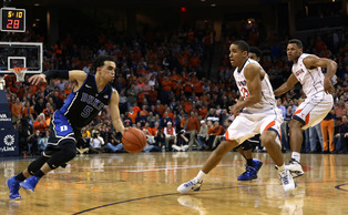 Tyus Jones led a furious run in the final 5:19 as the Blue Devils came back to stun the Cavaliers on the road.
