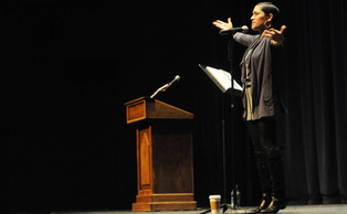 "Poet Mayda del Valle addresses a Reynolds Theater audience Monday night, discussing themes of famiy, relationships and bad pick-up lines. Del Valle said that  ""off-limit"" subjects are often the most captivating."