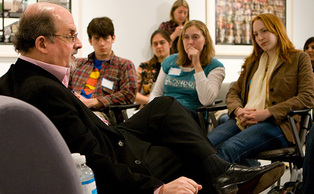 Author Salman Rushdie, pictured speaking to students, discussed the notion of viewing novelists as news gatherers bringing national issues to public attention.
