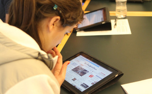 Richard Lucic, associate chair of the computer science department, has his students use iPads to learn the process of application development.