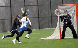 Senior Brigid Smith tied a career-high with four assists in Thursday's 14-7 quarterfinal win against Louisville.