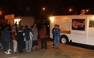 Bulkogi Korean BBQ truck and Parlez-Vous Crepe truck park in the Card Lot at midnight to serve hungry tenters in K-ville.