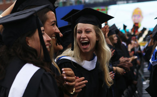 Despite threats of inclement weather, commencement 2015 went smoothly at the Durham Bulls Athletic Park Sunday morning.