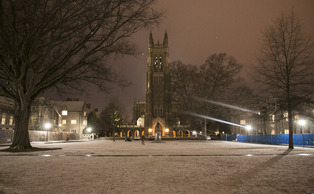 Snow settles over the Chapel Quadrangle Monday evening.