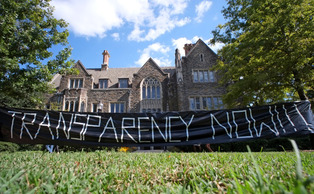 The student coalition DukeOpen used a banner in front of the Allen Building in Fall 2013 as part of its campaign to increase transparency of University investments. | Chronicle File Photo