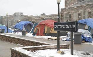 Students battle the elements in K-ville Tuesday during the end of  a storm that blanketed the tent city in snow and ice.
