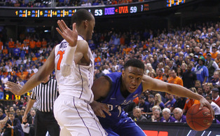 Virginia's Akil Mitchell forced Jabari Parker to work for each of his 23 points.
