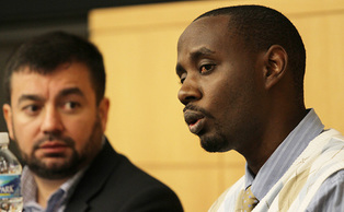 Muslim Chaplain Abdullah Antepli and Rwandan refugee Innocent Justice speak at the 2012 Winter Forum at the Fuqua School of Business.