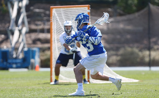 Freshman Justin Guterding scored three goals in his first Duke-North Carolina game, but it wasn't enough as the Blue Devils fell in Chapel Hill.