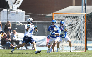 Redshirt freshman Danny Fowler made 13 saves for the Blue Devils in Sunday's 15-14 loss at North Carolina.