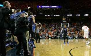 Freshman Tyus Jones put the dagger in Virginia's undefeated campaign with a 3-pointer with only 10.4 seconds remaining.