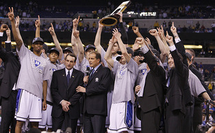 Coach Krzyzewski celebrates after his players win the 2010 NCAA championship tournament.