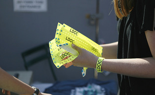 Students collect their wristbands in anticipation for the Last Day of Classes celebration.