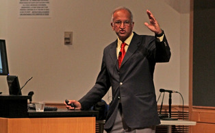 """Conservation is about being optimistic, but cautiously optimistic,"" Ullas Karanth warned at the event Tuesday night."