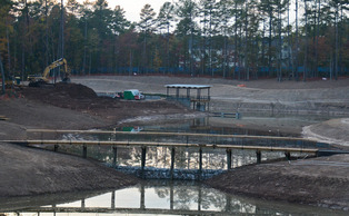 Plans for the reclamation pond began after a severe drought in 207.  The structure of the pond is completed and is beginning to fill with water.