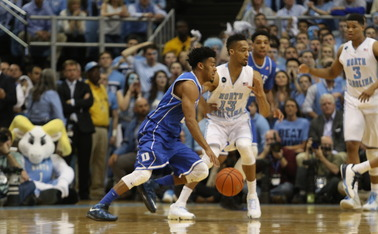 Quinn Cook hit four triples and finished with 20 points as Duke topped North Carolina in Chapel Hill.