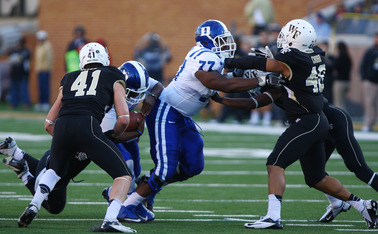 Blue Devil right guard Laken Tomlinson will present a stiff challenge for Elon's undersized defensive line to get after quarterback Anthony Boone Saturday.
