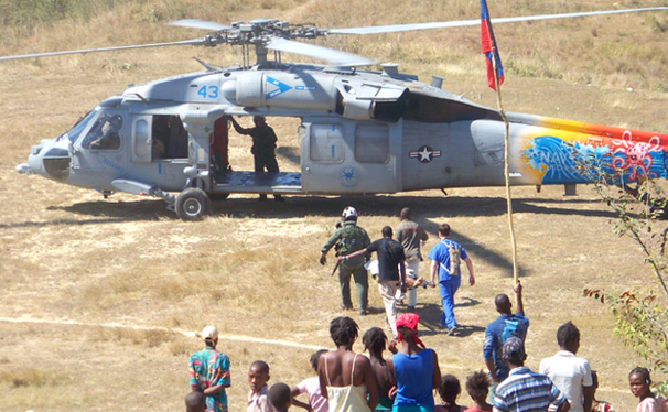 The Duke medical team in Haiti evacuates an earthquake victim via helicopter to the USNS Comfort, a navy hospital ship, for surgical treatment.