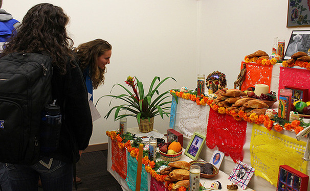 Students look at a food display at a Day of the Dead celebration photo exhibit in the Jameson Gallery. The exhibit will run through Nov. 6.