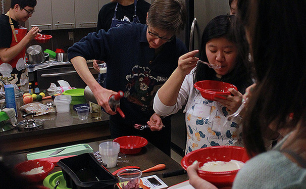 A freshman seminar taught by a chemistry professor and a professional chef applies basic principles of chemistry to cooking techniques. Students here experiment with making cheese.