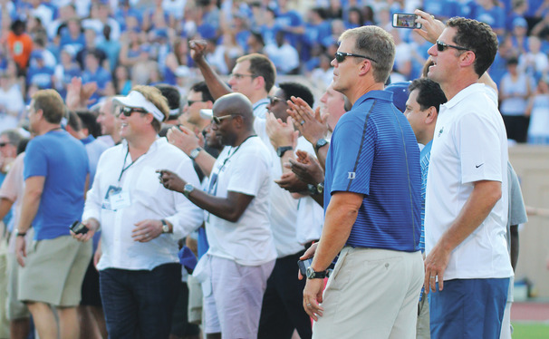 The 1989 ACC champion Blue Devil football team was honored at Saturday's season opener at Wallace Wade Stadium, a 52-13 Duke victory against Elon. Led by head coach Steve Spurrier, the '89 Blue Devils upset No. 7 Clemson and shared the conference title with Virginia.