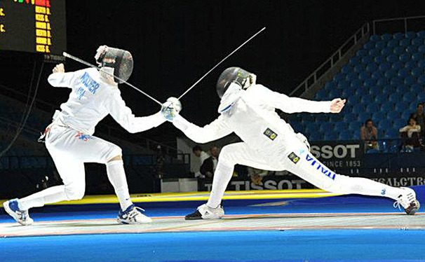 Duke fencer Dylan Nollner, left, defeats Italy's Andrea Santarelli at the 2012 Junior World Championships.