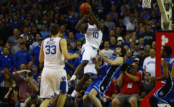 Ryan Kelly attempts to draw a change against Kentucky's Archie Goodwin.