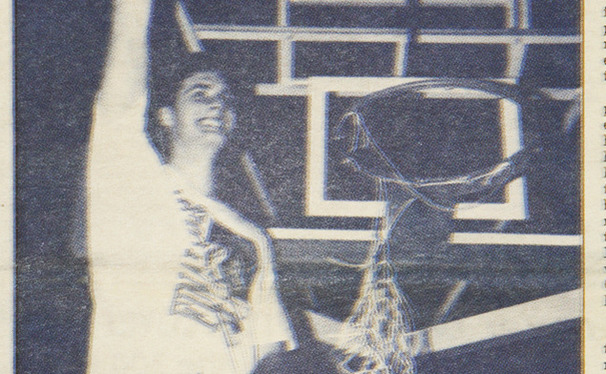 Christian Laettner cuts down the net following Duke's 1992 Elite Eight victory against Kentucky.