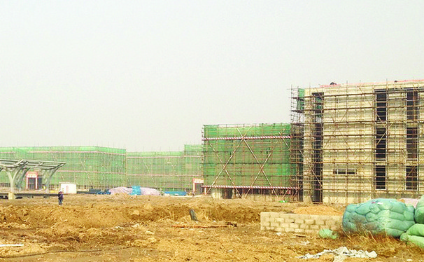 Duke Kunshan University in November 2012, after almost a year with no construction progress. Administrators and the city of Kunshan expect that the campus' first five buildings will be ready for students Fall 2014.