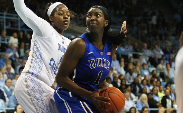 Senior Elizabeth Williams showed her experience Sunday night with a historic game against Duke's arch-rival.